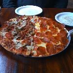The pizza.  Half Magazine, half double pepperoni.