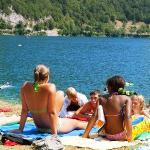 two girls on the lake ledro in camping al lago beach