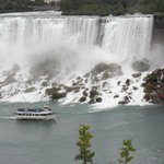 A view of the Maid of the Mist going by the Bridal Falls on it's way to the Horseshoe Falls.