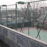 View of the hutong and tennis court.