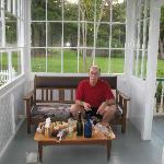 My husband enjoying cheese, meat, bread and wine on the porch.  It was such a delight that we we