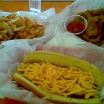 Chili cheese dog, fries and onion rings