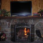 Wood-burning fireplace and TV
