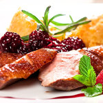 Medium grilled duck breast fillet with orange-flower flavoured blackberry sauce and potato dough