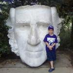 Luke with face of Sam Houston statue