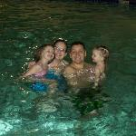 Swimming with his wife and daughters in hotel pool.