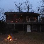 Front view of cabin with fire