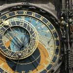 The clock face tells the time 3 different ways. None of which can be read by the average individ