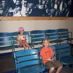 Sitting in seats from Yankee Stadium at the Roger Maris Museum.  It is a simple museum in the We