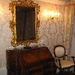 Gilded mirror with TV behind