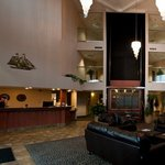 Grand Three Story Lobby with Glass Elevator