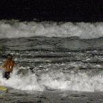 Surfers at night