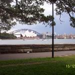 Sydney Harbor Bridge with the Opera House in the fore ground. Sydney, N S W, Australia.