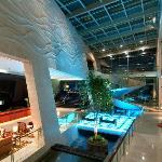Spacious sun drenched lobby with one of the kind 360 degrees spiral staircase