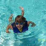 my granddaugther swimming at the pool