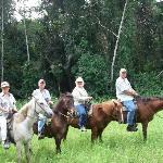 Horseback ride through the jungle at adjacent Banana Bank Resort
