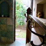 the outdoor shower beyond the door