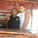 Bartender at beach bar and life guard