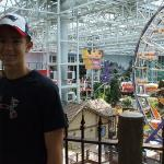 Alek posing in front of the theme park in the MIDDLE of the Mall of America