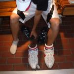Alek trying on Bubba Gump's tennis shoes