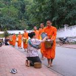 Monks outside the hotel - owner giving donation