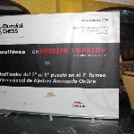 Cartel de la simultánea de MundialChess en el hall del Hotel Aníbal