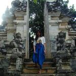 At Uluwatu Temple. Women who wear shorts have to cover their legs to enter the temple.