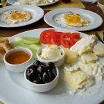 Breakfast with Mine. Most breakfasts are pretty similar, olives, cucumbers, tomatoes, different
