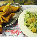 Fried catfish, fries, and a ceasar salad