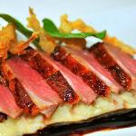 Smoked Moulard Duck Breast with red miners lettuce, crispy onions, risotto, and foie gras gastri