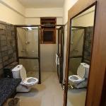 The bathroom in the standard guest room of Hotel Iora, The Retreat at Kaziranga National Park, A