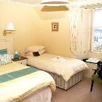 The front double room with sea views & en-suite shower room