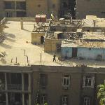 A glipse of the peaople living on the roofs of Cairo