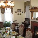 The table was set for breakfast every morning with fresh fruit, a fire in the fireplace, and cla