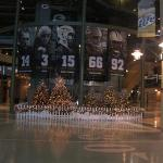 christmas lights in the atrium at lambeau, on the backdrop of the packers retired numbers