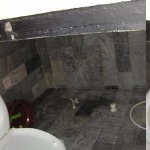 A dirty little toilet and shower