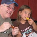 Rachel and Dad enjoying wings at Hershey Park.