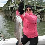 Sheri with a 10 lb red fish