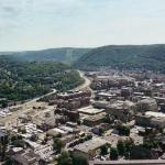 Top view of Johnstown, PA, see river that is where dam broke at top of mountain in 1889