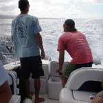 Teaching us how to fish off the boat!