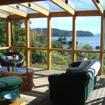 Sprawling views of Halfmoon Bay from the sundrenched conservatory