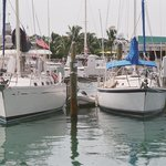 Two Sailboats, side by side in historic seaport