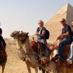 The camel guides are more than happy to take pictures for you.  The Pyramid of Khefre in the bac