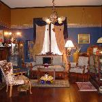 Our Walnut, Eastlake inspired Gent's Parlor with original walnut fireplace mantle/tiles