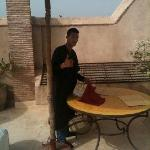 Abdul setting out breakfast on the terrace