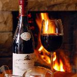 A Good Bottle of Red by our Fire!