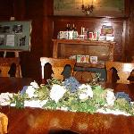 Partial view of the dining room table that seats 18 guests