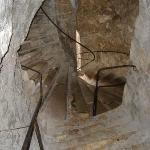 Dover Castle - A stairwell merges with a spiral staircase.