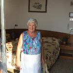 Lenna (owner/chef) shows our room