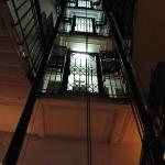 The elevator shaft looking up from the lobby.